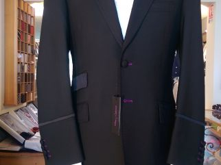 Model Prince, Dress Jacket in black wool. Silk/Wool contrasts Trousers and waistcoat available Shirt white cotton Tie 100% silk