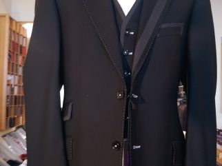 Model 3-A lapel insert Jacket, and Waistcoat in black wool,with contrasts. Trousers available White cotton shirt Tie in 100% silk
