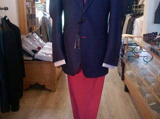 Blazer in Wool/ Mohair,  Red contrast stitching and Buttonholes. Navy silk contrasts insert Available in series, made to order or made to measure, in various colours. Casual Jean style trousers in Red cotton & Stripe cotton shirt made to order or mad